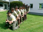 Ranger in front of the National Park Authority Caption: Nine rangers all in a row